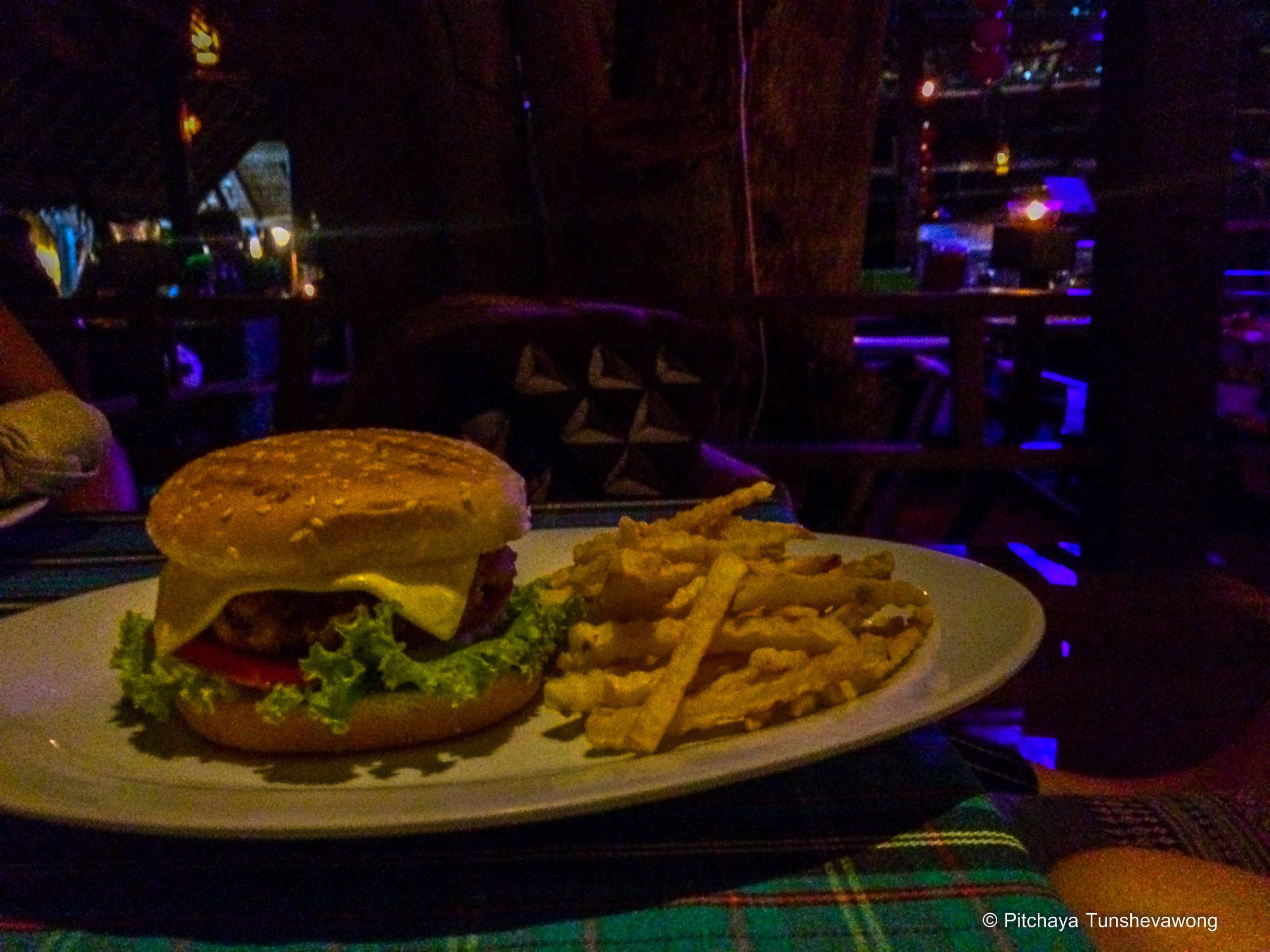 A plate of beef burger during the raining evening